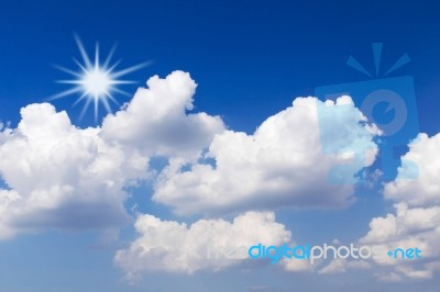 blue-sky-with-white-clouds-and-sun-100233194